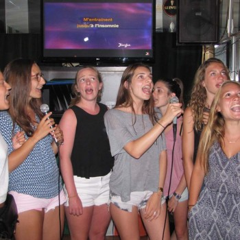 Students singing in karaoke