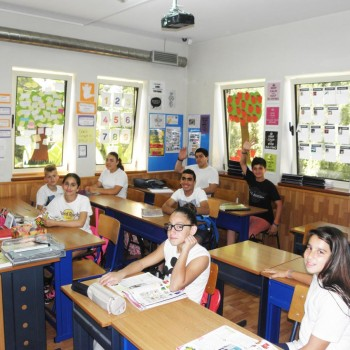 students learning english in classroom
