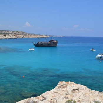 blue sea with boats in cyprus